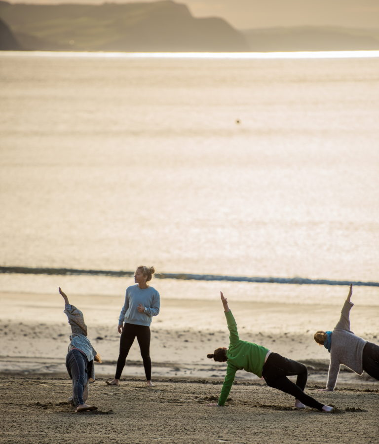 Lyme Rgis beach group yoga class with Pip
